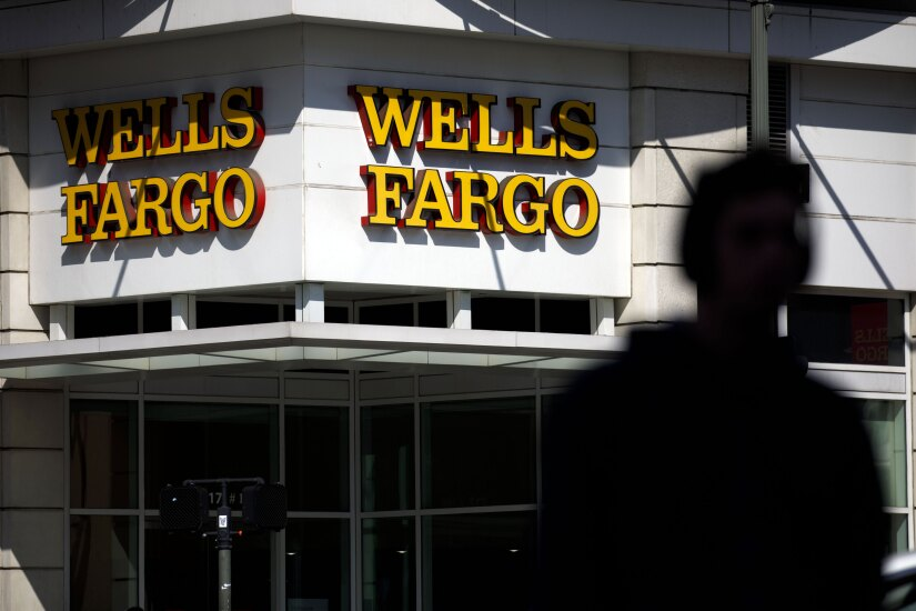 Signage is displayed outside a Wells Fargo bank branch in Los Angeles.