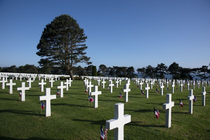 French national flags and American flags at the World War II Normandy American Cemetery and Memorial in Colleville-sur-Mer, France, on June 6, 2019.
