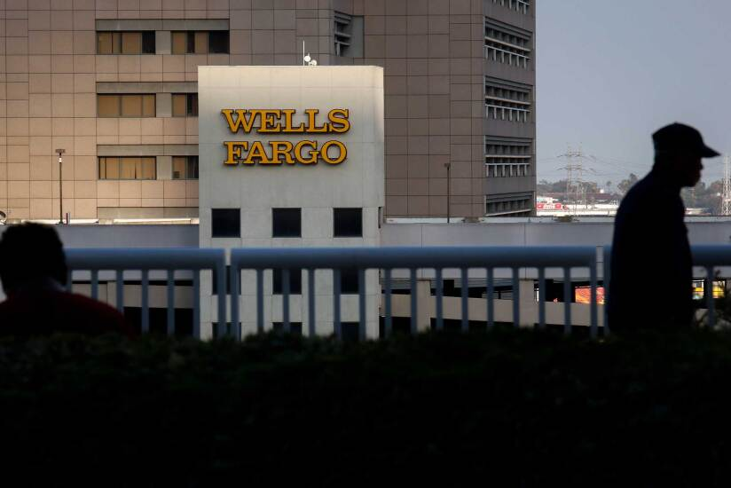 Wells Fargo bank logo at dusk Bloomberg News