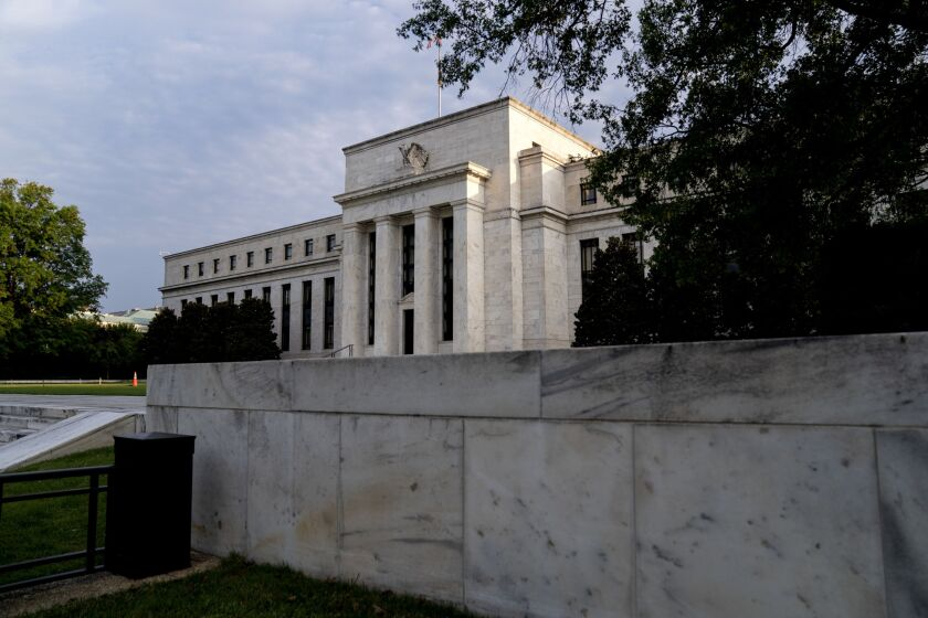 """""""A large net share of banks has lowered the minimum required credit rating for credit card loans, while moderate net shares of banks have lowered that for auto loans and other consumer loans, """"said a survey of senior loan officers at the Federal Reserve."""