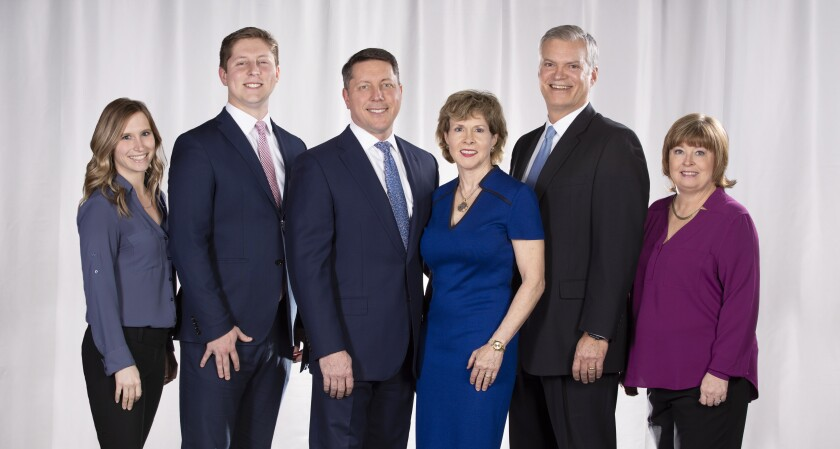 The Bellars Harris Wealth Management team includes, left to right, Laura Savage, client service associate; Axel Bellars, vice president; partners Tim Bellars, Claudia Bellars and Brad Harris; and Jeannie Hughes, client service manager.