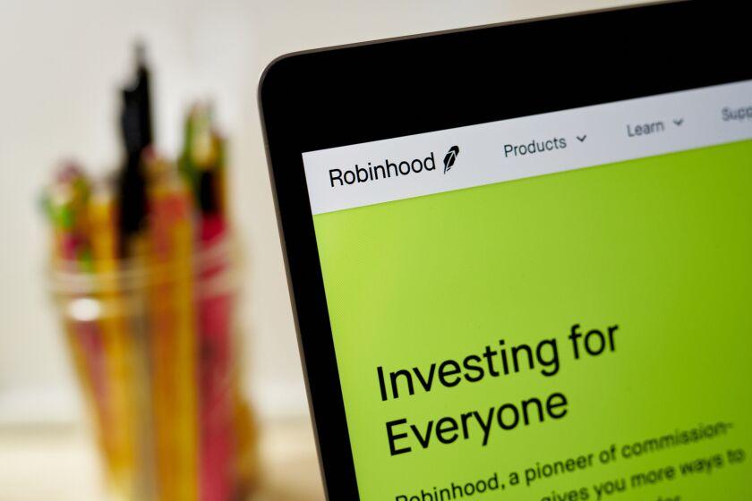 Robinhood website home screen displayed on a laptop computer 2020