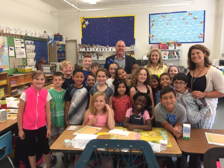 BlumShapiro chief marketing officer Tom DeVitto (center rear), Fox 61 anchor Jenn Bernstein and teacher Brenda Glidden with a third grade class at Webster Hill School.