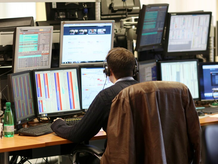A trader sits and monitors his computer.