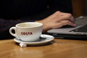 Costa coffee cup with computer