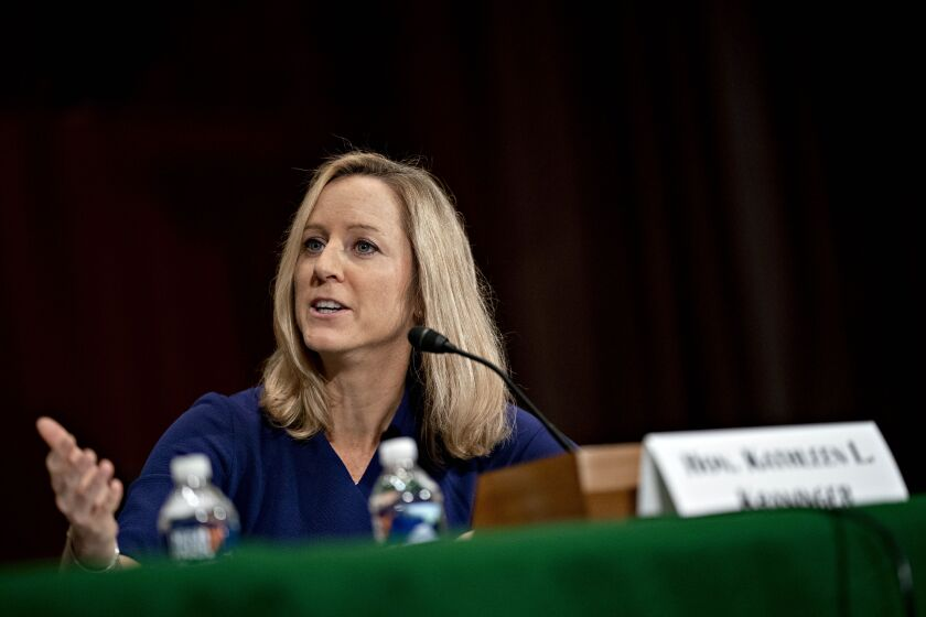 The lawsuit filed Tuesday alleges the CFPB and Director Kathy Kraninger were biased in choosing the five-member task force chaired by Todd Zywicki, a law professor at George Mason University's Antonin Scalia Law School.