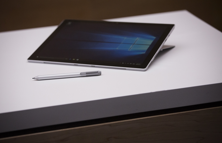 Tablet and stylus sit on a table top