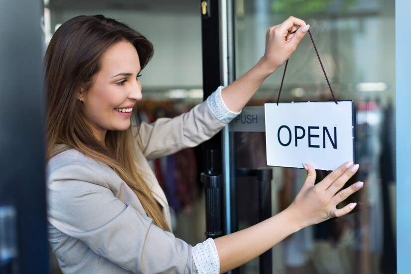 Open for business sign - woman