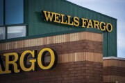 Signage is displayed outside a Wells Fargo & Co. bank branch in Palatine, Illinois, U.S., on Tuesday, July 10, 2018. Wells Fargo & Co. is scheduled to release earnings figures on July 13.