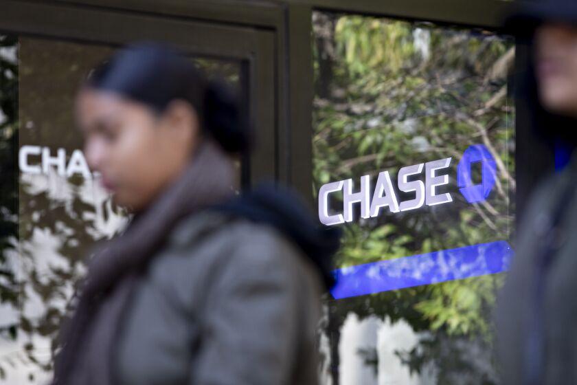 A pedestrian walks past a JPMorgan Chase branch.