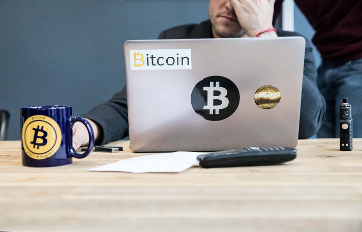 Bitcoin trader takes a moment from a busy day at his desk.