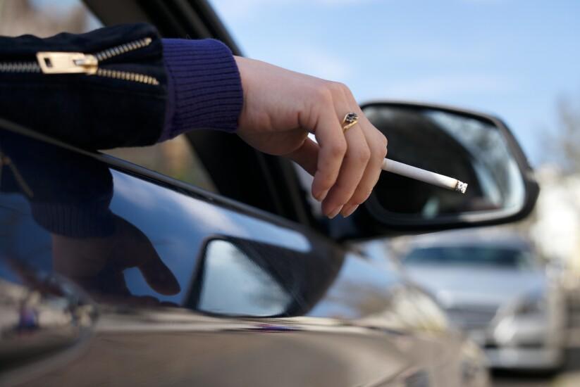 Cigarette and car mirror