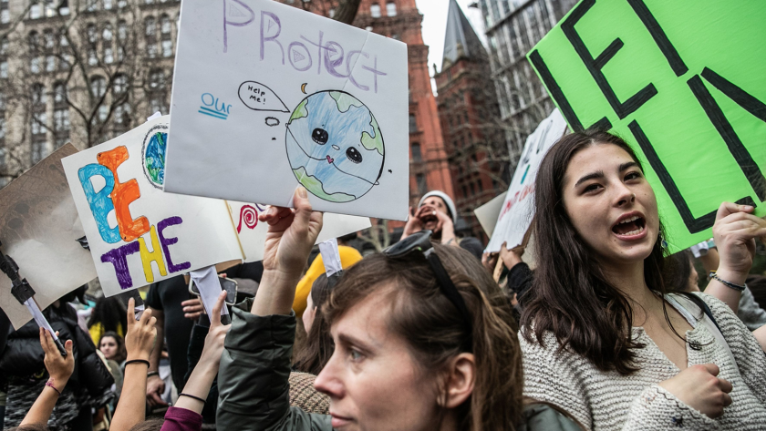 Demonstrators hold signs during the Youth Climate Strike in New York this spring.