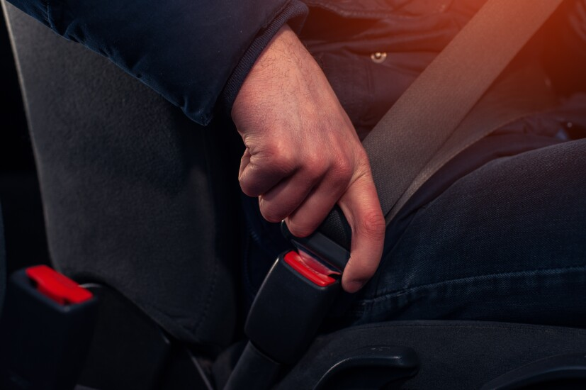 Buckling a seatbelt