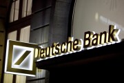 An illuminated sign for Deutsche Bank outside a bank branch in Frankfurt, Germany.