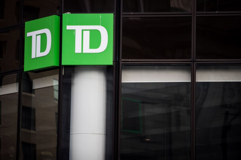 Signage is displayed outside a Toronto-Dominion bank branch in Vancouver.