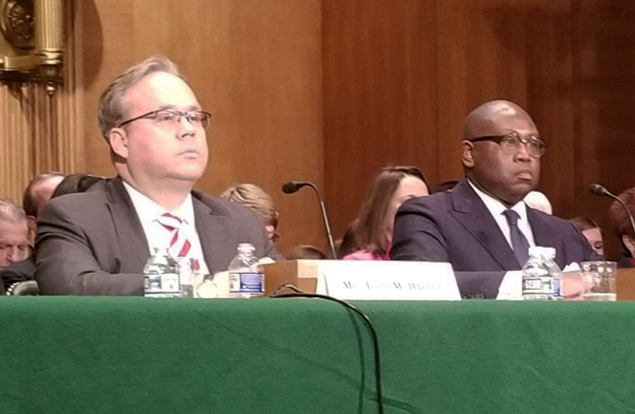 Todd Harper, left, and Rodney Hood, nominees to the National Credit Union Administration board, seen here during a Feb. 14, 2019 confirmation hearing before the Senate Banking Committee