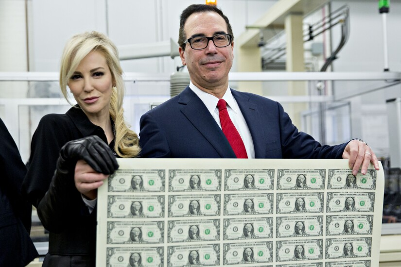 Treasury Secretary Steven Mnuchin with wife, actress Louise Linton. Also with money, currency
