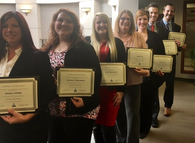OMNI's Community CU's 2017 Developing Leaders Class proudly displays their certificates of accomplishment.