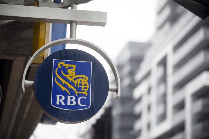 Signage is displayed outside of a Royal Bank of Canada (RBC) branch.