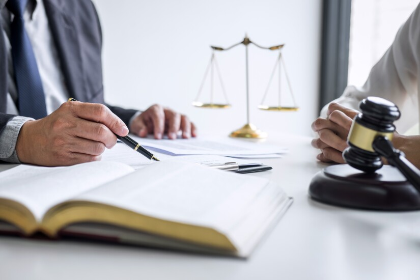 Consultation and conference of professional businesswoman and Male lawyers working and discussion having at law firm in office. Concepts of law, Judge gavel with scales of justice