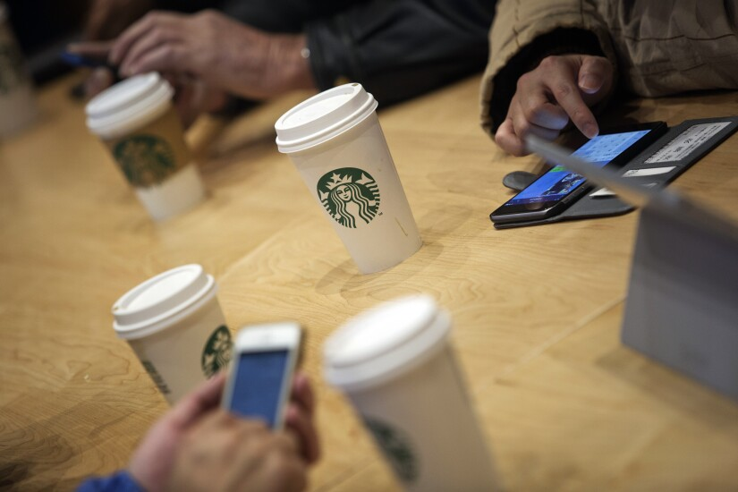 Starbucks patrons can't keep off their mobile phones.
