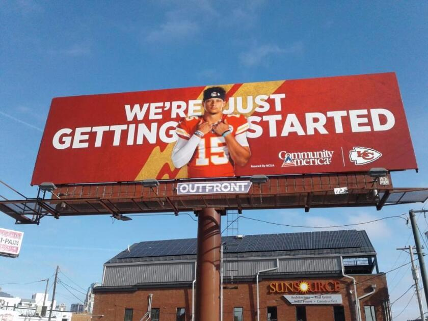 A CommunityAmerica Credit Union billboard featuring Kansas City Chiefs star Patrick Mahomes. CACU became the team's official banking sponsor in 2019.