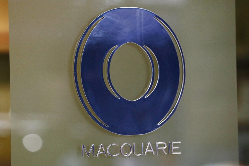Macquarie Group is cutting about 100 equity research and sales jobs in London and New York, according to people familiar with the situation.