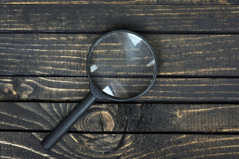 magnifying-glass-adobe-117631502