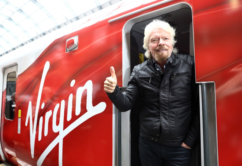 Richard Branson, Virgin Group founder and British billionaire, poses on a new high speed train in London in 2016.