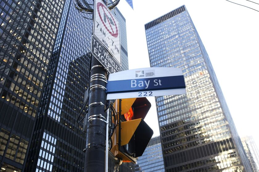 "A ""Bay Street"" sign is displayed in the financial district of Toronto."