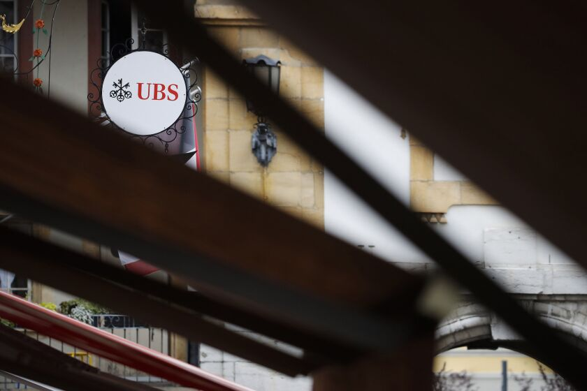 A sign hangs on display outside a UBS Group AG bank branch in Murten, Switzerland, on Wednesday, July 15, 2020. U.S. President Donald Trump'strade warwith China is spurringUBS's $2.2 billionmulti-strategy hedge fund to make its biggest push yet into the Asian nation.