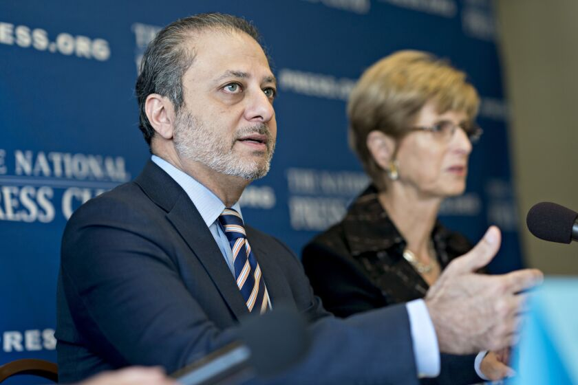 Preet Bharara, former U.S. attorney for the Southern District of New York, speaks as Christine Todd Whitman, former governor of New Jersey, right, listens during a news conference at the National Press Club in Washington, D.C., U.S., on Tuesday, Oct. 2, 2018. The two co-chairs of the National Task Force on Rule of Law and Democracy announced recommendations to strengthen government ethics and protecting against interference in the work of law enforcement. Photographer: Andrew Harrer/Bloomberg