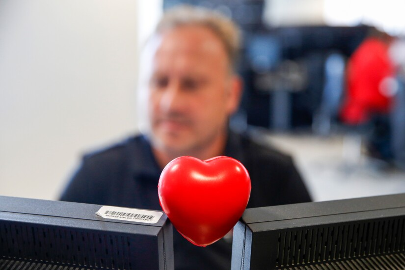 heart with computer by Bloomberg News