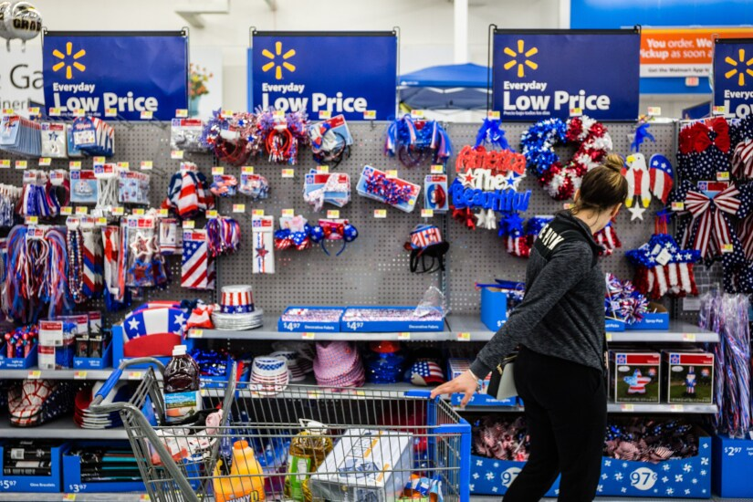 A customer views American flag themed decorations for sale at a Walmart Inc. store in Secaucus, New Jersey.