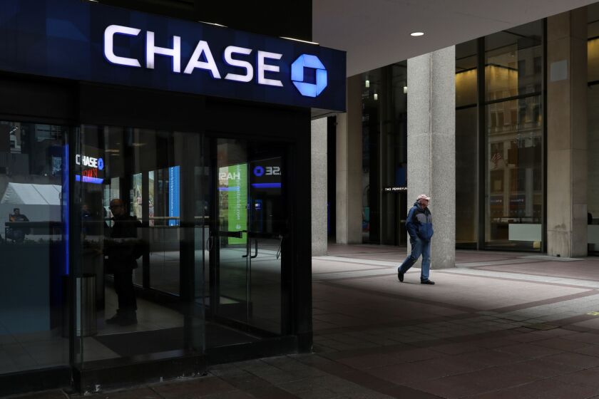 A pedestrian passes in front of a JPMorgan Chase bank branch outside Pennsylvania Station in New York Feb. 5, 2020. New York City has for decades talked aboutimproving the neighborhood around antiquated Pennsylvania Station with the kind of development that's invigorated other parts of Manhattan. Real estate billionaireSteven Rothis finally seizing the moment. Photographer: Bess Adler/Bloomberg