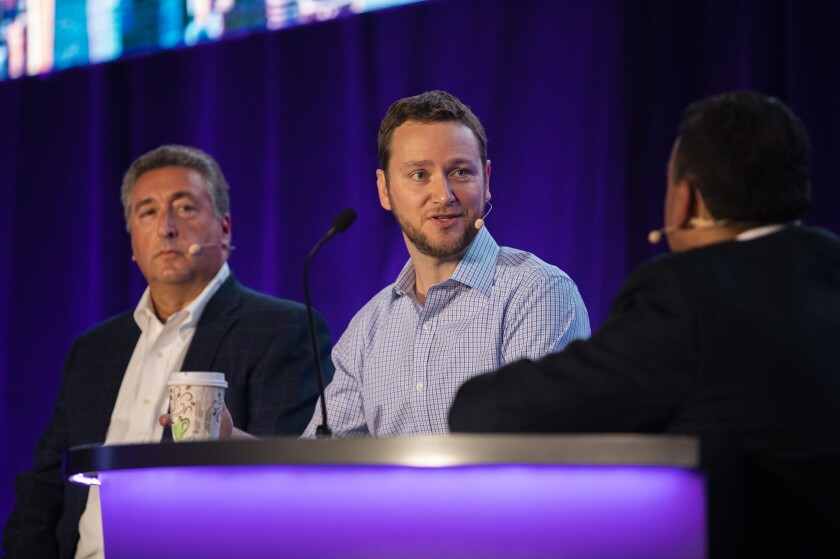 """""""The future will not be written by the large incumbents,"""" says Betterment CEO Jon Stein (center), who spoke on an In