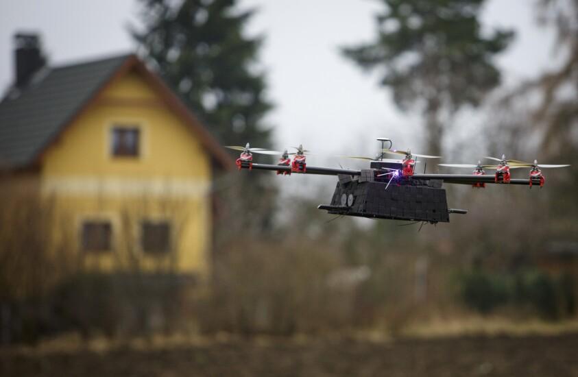 flying drone near house