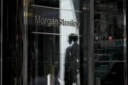 A pedestrian is reflected in the exterior of Morgan Stanley headquarters in New York, U.S., on Thursday, July 12, 2018. Morgan Stanley is scheduled to release earnings figures on July 18. Photographer: Bess Adler/Bloomberg