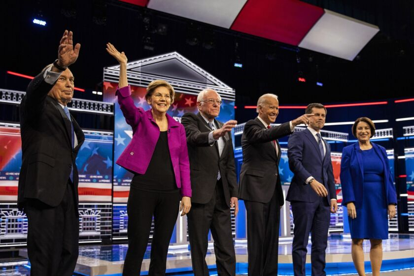 2020 presidential candidates Mike Bloomberg, founder of Bloomberg LP, from left, Senator Elizabeth Warren, a Democrat from Massachusetts, Senator Bernie Sanders, an Independent from Vermont, former Vice President Joe Biden, Pete Buttigieg, former mayor of South Bend, and Senator Amy Klobuchar, a Democrat from Minnesota, stand on stage ahead of the Democratic presidential candidate debate in Las Vegas