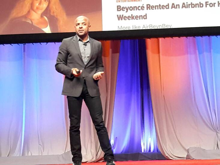 Jonathan Mildenhall, former chief marketing officer for Airbnb, speaking during CUNA's 2018 ACUC in Boston.