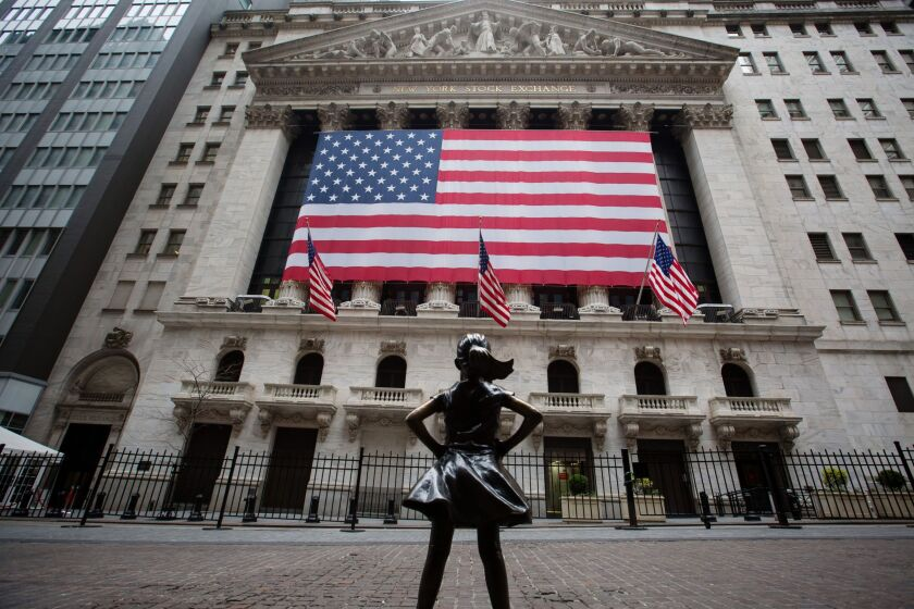 The Fearless Girl statue stands across from the New York Stock Exchange in New York on March 30, 2020.