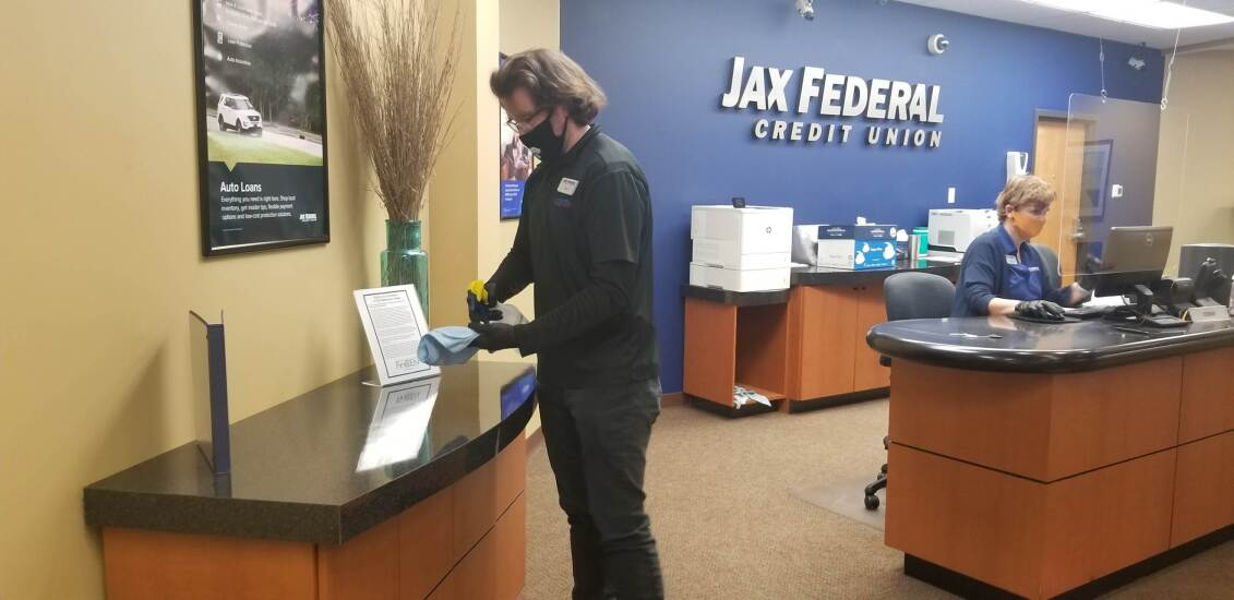 Employees at Jax Federal Credit Union now wear masks on the job to help protect against the coronavirus.