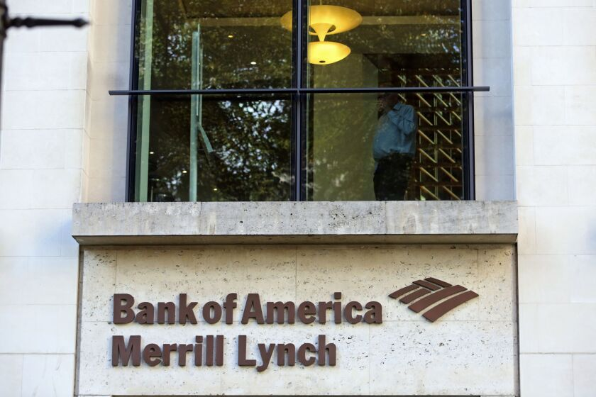A sign sits beneath an office window at the Bank of America Merrill Lynch Financial Centre in London, U.K., on Thursday, Oct. 9, 2014. Norway's sovereign wealth fund Norges Bank Investment Management, the world's largest, agreed to buy the Bank of America Merrill Lynch Financial Centre in London for 582.5 million pounds ($944 million) as it expands its bet on the U.K. capital. Photographer: Chris Ratcliffe/Bloomberg