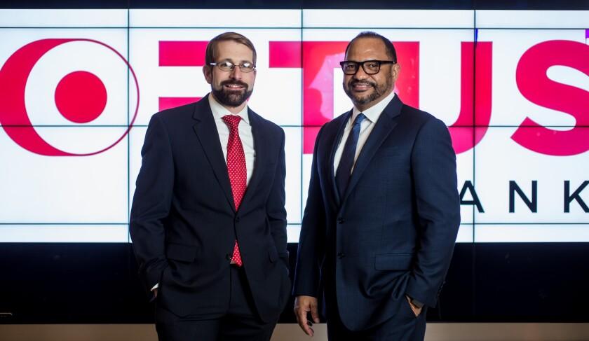 Dominik Mjartan, CEO of Optus Bank; Paul Mitchell, chairman of Optus Bank