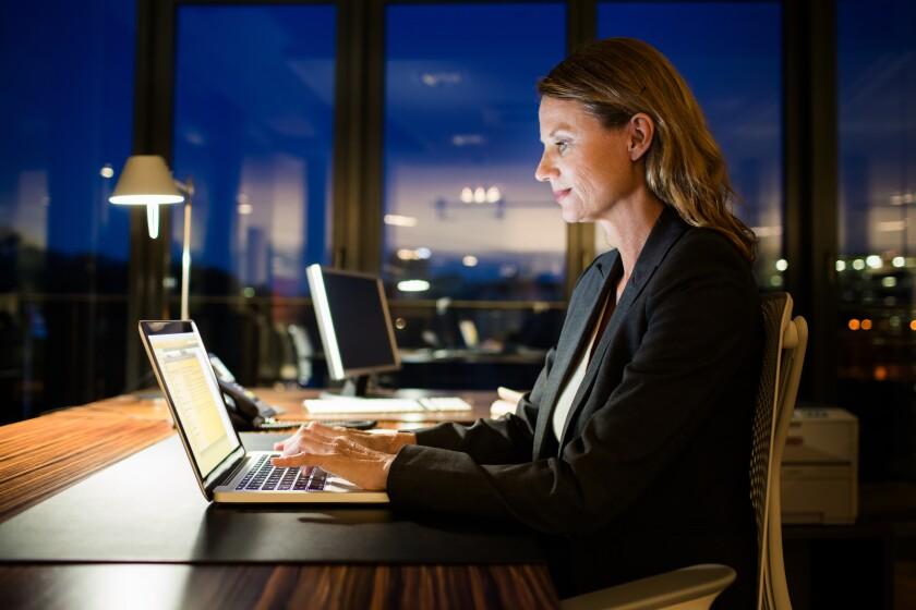 Woman.WorkingLate.Getty.jpg