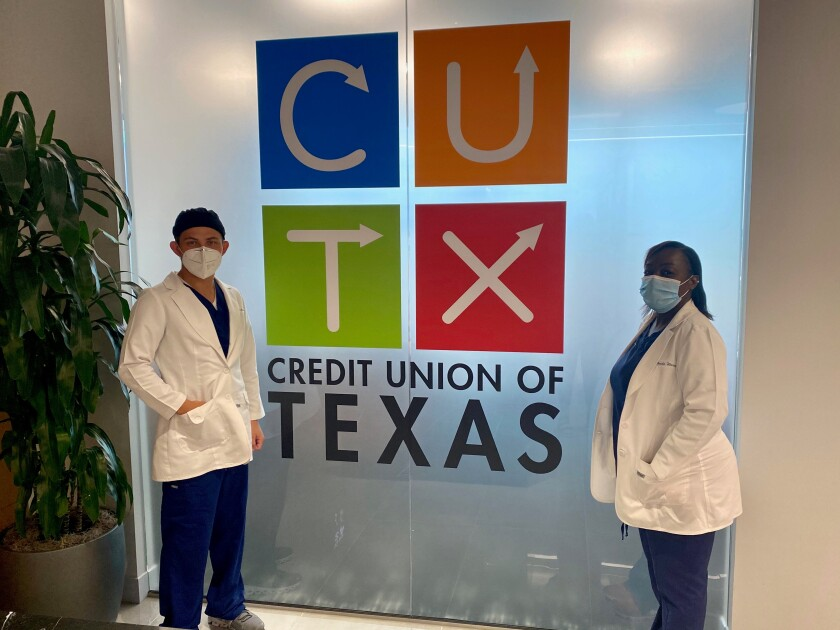 Medical technicians on site at Credit Union of Texas for COVID-19 antibody testing.