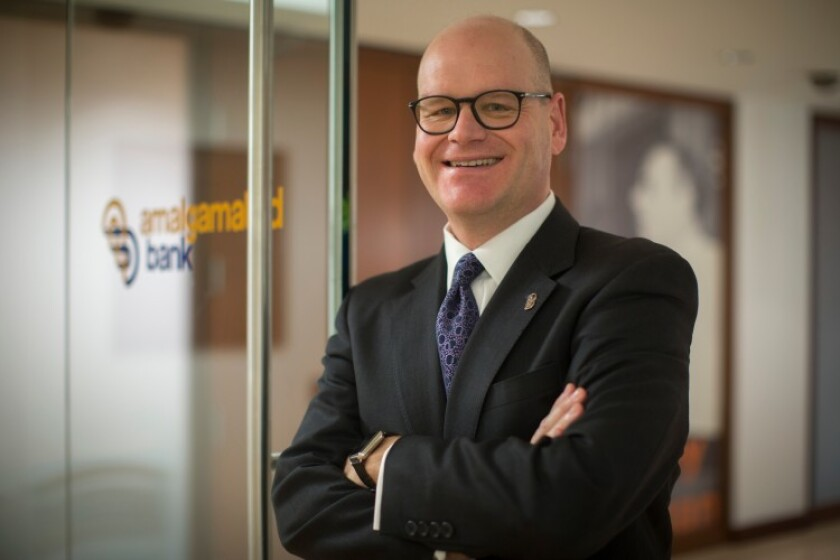 Keith Mestrich will step down as CEO of Amalgamated Bank early next year.