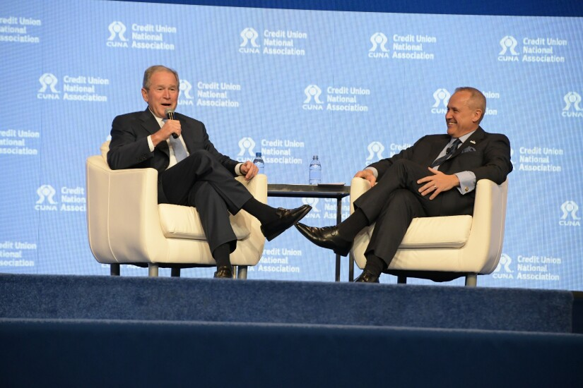 Former President George W. Bush and CUNA President and CEO Jim Nussle on stage during the 2018 CUNA GAC in Washington. Nussle, a former Iowa congressman, was Bush's budget director from 2007-2009.