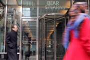 Pedestrians walk by the headquarters of Bear Stearns Friday January 6, 2006 in New York.